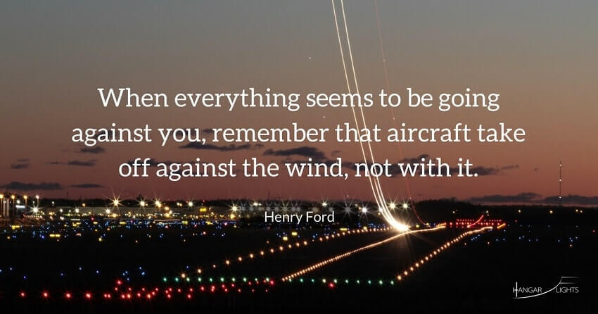Henry Ford aviation quote - When everything seems to be going against you, remember that aircraft take off against the wind, not with it.